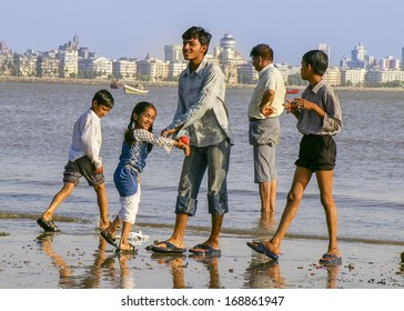 MUMBAI - MARCH 26: A family plays together on Juhu Beach, a busy urban recreational area, on March 26, 2006 in Mumbai.