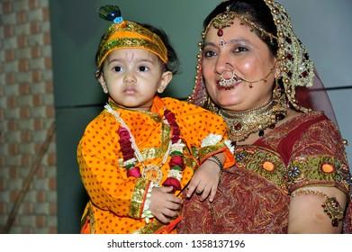 Mumbai; Mhaharashtra; India- May 31; 2012 : Little Baby Krishna's Mother Yashoda carrying new born Baby (krishna) on Janmashtami in vector it is dummy scene