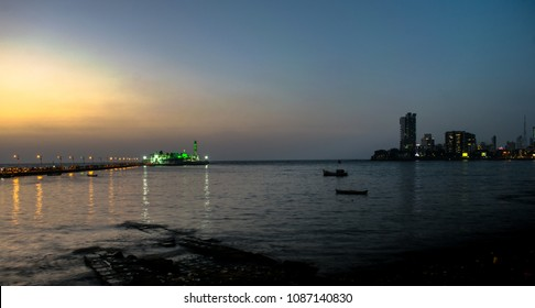 mumbai skyline and haji ali dargah after sunset.
