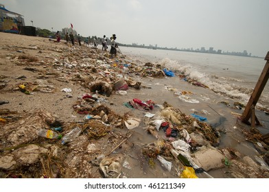 MUMBAI,INDIA, 23 SEPTEMBER 2010 : Sea pollution from garbage after  immersion of Ganesha, and Chaupati Beach in south Mumbai after Hindu festival of immersion of Ganesha in to the sea ends.