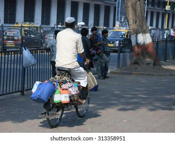 Mumbai/India - 24/11/14 - Dabbawala delivering out on a bicycle at Churchgate Railway Station