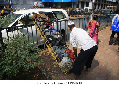Mumbai/India - 24/11/14 - Dabbawala delivery at Churchgate Railway Station in Mumbai with dabbawala placing the tiffin carry crate on the ground
