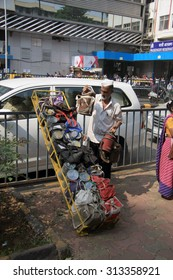 Mumbai/India - 24/11/14 - Dabbawala delivery at Churchgate Railway Station in Mumbai with dabbawala unloading tiffins