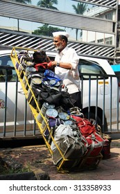 Mumbai/India - 24/11/14 - Dabbawala delivery at Churchgate Railway Station in Mumbai with dabbawala unloading the first few tiffins