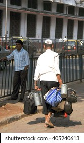 Mumbai/India - 24/11/14 - Dabbawala delivery at Churchgate Railway Station in Mumbai with dabbawala carrying tiffins