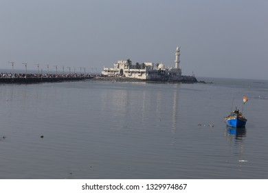 Mumbai,India December 29,2018:The Haji Ali Dargah is a mosque and dargah (tomb) or the monument of Pir Haji Ali Shah Bukhari located on an islet off the coast of Worli in the southern part of mumbai