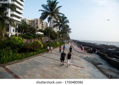 MUMBAI/INDIA - June 6, 2020: Residents walk on Bandra bandstand promenade as the government eases nationwide lockdown.