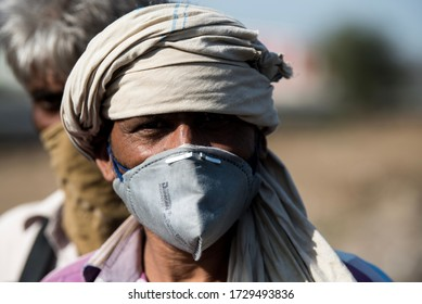 MUMBAI/INDIA - MAY 11, 2020: Migrant workers wearing mask on their journey back home during a nationwide lockdown to fight the spread of the COVID-19 coronavirus.