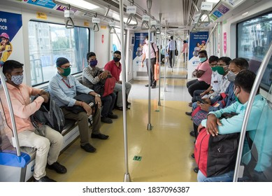 MUMBAI/INDIA - October 19, 2020: Passengers wear masks while travelling on metro after the metro rail network resumed services following its closure due to the Covid-19 coronavirus pandemic.