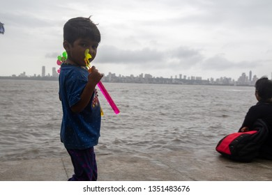 Mumbai,India,8-17-2018:Poor homeless and underprivileged children selling toys at marine drive. These children earn to contribute to their family income.Children are doped out of school for working.