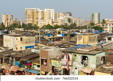 Mumbai,India-November 3,2017: Construction of skyscrapers and slums creates strong conflict.Mumbai one of the biggest city in the world.Real Estate market growing very rapid.
