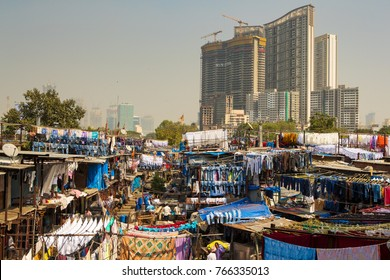 Mumbai,India-November 4,2017: Laundry service in Dhobi Ghat. Construction of skyscrapers and slums creates strong conflict.Real Estate market growing very rapid.