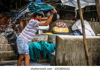 Mumbai's manual clothes washing man. 6-8-2016.Mumbai has this 100 years old manual washing area called 'Dobighat' in center of Mumbai city. Bulk laundries are washed here every day.