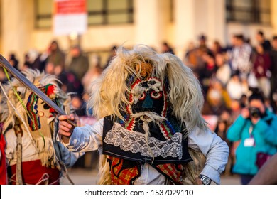 Mummers perform rituals to scare evil spirits at Surva festival at Pernik in Bulgaria. The people with the masks are called Kuker (kukeri). Mask from woon.