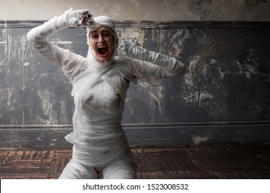 mummy screams in horror and tears the bandages. The girl with the bandage. Halloween
