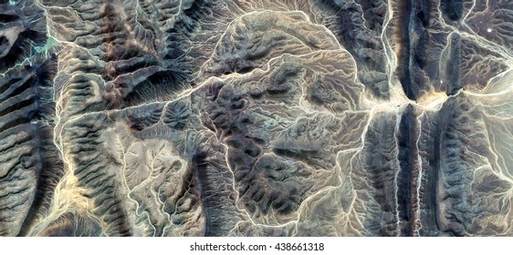 the Mummy, stone face, abstract photography of the deserts of Africa from the air, Science fiction,Photographs magic,artistic,landscapes of your mind, optical illusions, abstract art