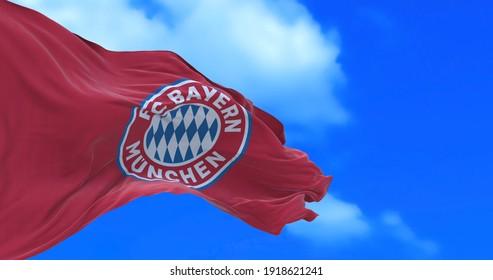 Munchen , Germany - 17 February 2021 - Waving flag of German football club FC Bayern Munich.