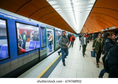 MUNCHEN, GERMANY - MAY 9, 2017 : People on the Marienplatz subway station on the U6 subway line in Munich, Germany. About 350 million passengers ride the U-Bahn every year.