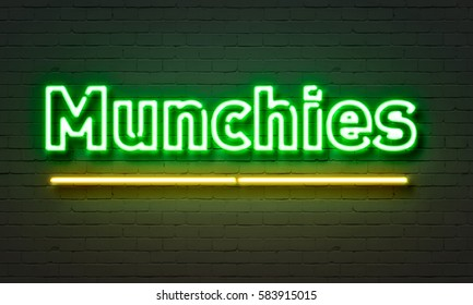 Munchies neon sign on brick wall background