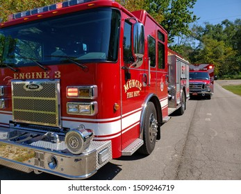 Muncie, Indiana / United States - 9-19-19 - Fire Engine E-3 Driver side angle on street with EMT ambulance behind and tress and blue sky