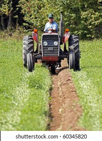 MUNDLEVILLE, CANADA - AUGUST 31: DJ Mundle competes at the 2010 New Brunswick Provincial Plowing Match and Canadian Plowing Championships on August 31, 2010 in Mundleville, Canada.