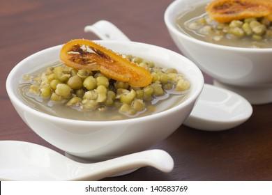 Mung Bean Broth with Candied Orange Garnish. Non sharpen file