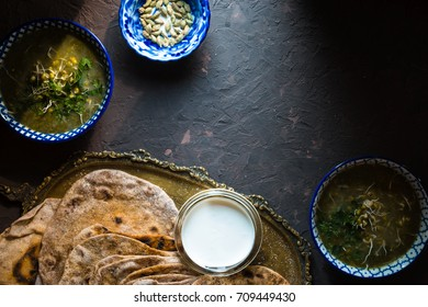 Mung bean soup and chapatti on the dark background