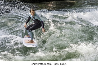 MUNICH - AUGUST 08: female surfer works the wave at the Surf & Style 2015  Anniversary August 08, 2015 in Munich.