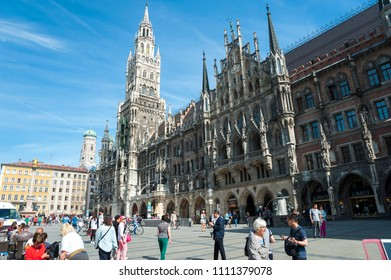 Munich, Bavaria/ Germany- 05/21/2018: Tourists and visitors enjoy exploring Munich's historic Marienplatz on a pleasant day.