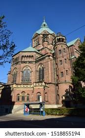 Munich, Bavaria / Germany - 08.22.2015: Red brick St Luke church (LUKASKIRCHE) at the ISAR river