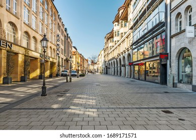 Munich ¬ Bavaria - Germany, 31. March 2020: Empty Sendlinger Strasse and city center of Munich, Germany because of shutdown due to corona virus