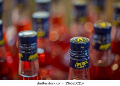 MUNICH, BAVARIA / GERMANY - April 4, 2019: Close up of Aperol bottles. The brand Aperol belongs to the Campari Group. The most famous cocktail made out of Aperol is the so-called Aperol Spritz.
