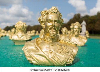 """MUNICH, BAVARIA / GERMANY - Aug 26, 2018: Close up of golden colored bust of King Ludwig II - exhibited in Nymphenburg Palace. The """"fairytale"""" king initiated the construction of Neuschwanstein Castle."""