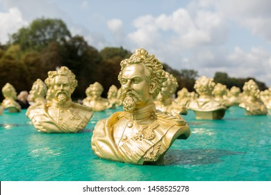 MUNICH, BAVARIA / GERMANY - Aug 26, 2018: Golden colored sculpture of King Ludwig II. In total 100 busts of the fairytale king were shown at an art exhibition at Nymphenburg Palace.