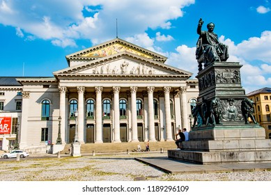 Munich, Bavaria / Germany - August 20 2018: A statue of King Maximilian I on the Max-Joseph-Platz in front of the National Theater. The Opera House is home to the Bavarian State Opera.