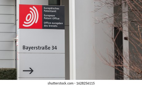 MUNICH, BAVARIA / GERMANY - Jan 21, 2020: Sign in front of the European Patent Office (EPO) Headquarters. With an arrow pointing towards the entrance. Registration of patents, intellectual property.