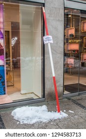 Munich, Bavaria / Germany - January 12 2019. Sign warning for snow at a shop.