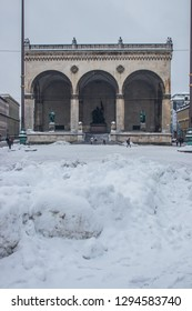 Munich, Bavaria / Germany - January 12 2019. View of Odeonsplatz in Munich after days of heavy snow with piles of snow. Snow covered street and place.