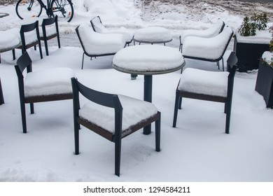 Munich, Bavaria / Germany - January 12 2019. Chairs and tables outdoors covered with snow.