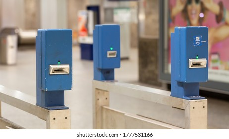 Munich, Bavaria / Germany - July 1, 2020: Ticket validators at the entrance of the Karlsplatz Stachus S-Bahn station. Passengers have to insert tickets to validate them before entering the platform.