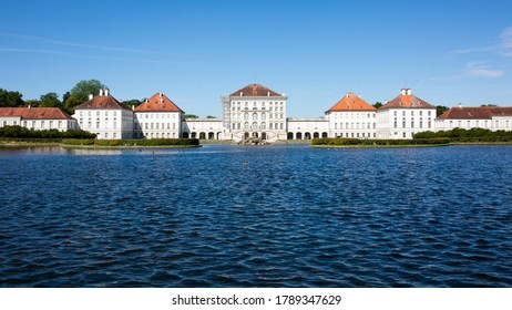 Munich, Bavaria / Germany - July 8, 2020: View on Schloss Nyphmenburg with water in the foreground. Nymphenburg Palace is one of the landmarks of Munich.