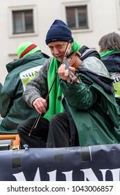 MUNICH, BAVARIA, GERMANY -  MARCH 13, 2016: close up on Irish man playing skillfully his violin at the St. Patrick's Day Parade.