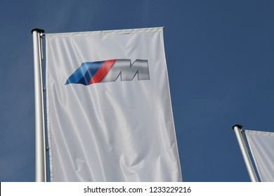 Munich, Bavaria / Germany - May 19, 2018: Flag with the logo of the car manufacturer BMW M in front of the headquarters in Munich, Germany - BMW M GmbH is a subsidiary of BMW AG