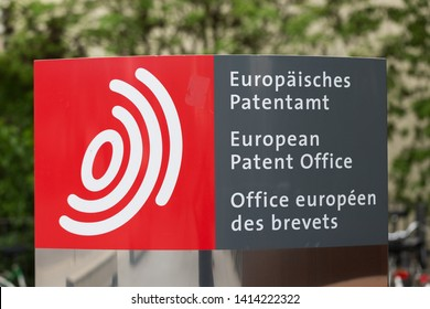 MUNICH, BAVARIA / GERMANY - May 25, 2019: Signpost at the entrance of the European Patent Office headquarters in Munich (EPO). In 2018 the EPO received 174.000 applications. Close up of logo / sign.