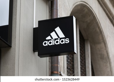 MUNICH, BAVARIA / GERMANY - Oct 2, 2019: Close up view on Adidas sign / logo. Adidas designs and manufactures shoes, clothes and accessories. The company is listed and part of the German Dax index.