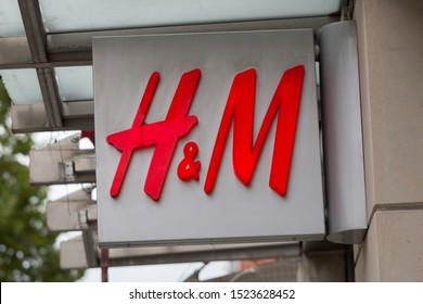 MUNICH, BAVARIA / GERMANY - Oct 2, 2019: Close up view on H&M logo / icon. The swedish clothing retail company is known for its fast-fashion. The company was founded in 1947. Multinational cooperation