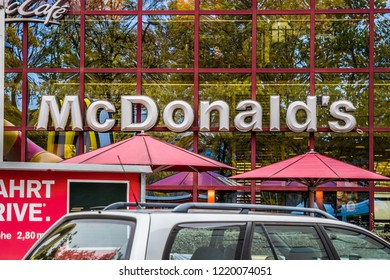 Munich, Bavaria, Germany - October 30 2018. Mc Donalds Logo in front of a Mc Donalds Fastfood Restaurant.