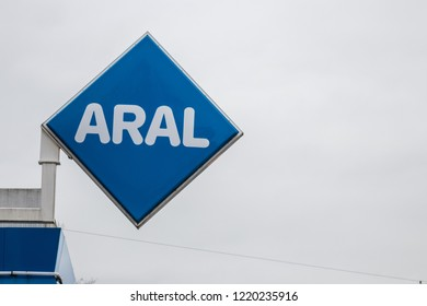 Munich, Bavaria, Germany - October 30 2018. ARAL gas station sign in front of a grey sky.