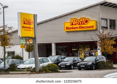 Munich, Bavaria, Germany - October 30 2018. Netto supermarket with parking lot. Large netto marken discount signs.
