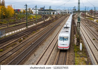 Munich, Bavaria, Germany - October 30 2018. ICE, Intercity Express train in white and red color on railtracks in munich.